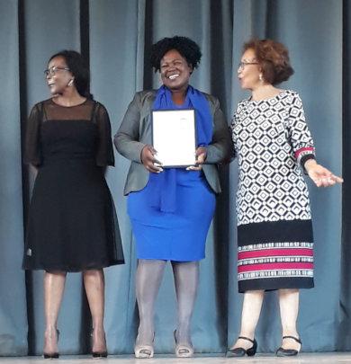 Ms Agnes Gqoboka Receiving her Certificate