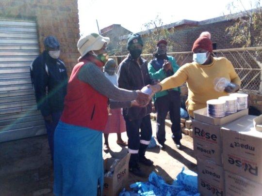 Mamokete receiving food parcel