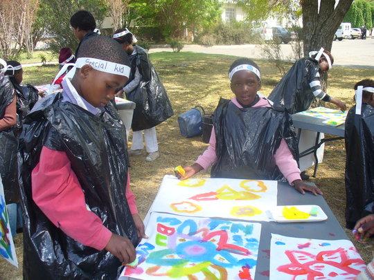 Children enjoying the painting activity