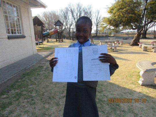 Proudly showing off her certificate