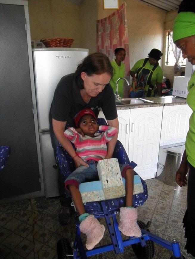 Bophelong beneficiaries receiving wheelchairs.