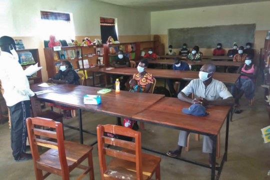 Teachers wearing masks at the library - late June