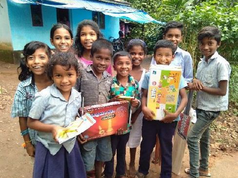 Kids receive school and play supplies