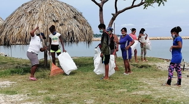 Youngsters clean up the beach.