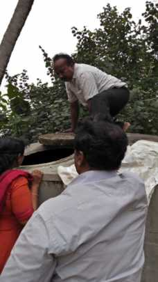 Parents cleaning water tank in school