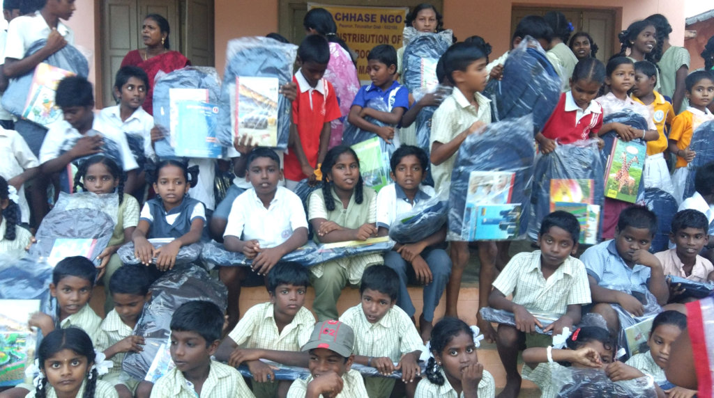 Children are happy with school bag,note books Etc.
