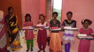 School bag and note books to tribal girls