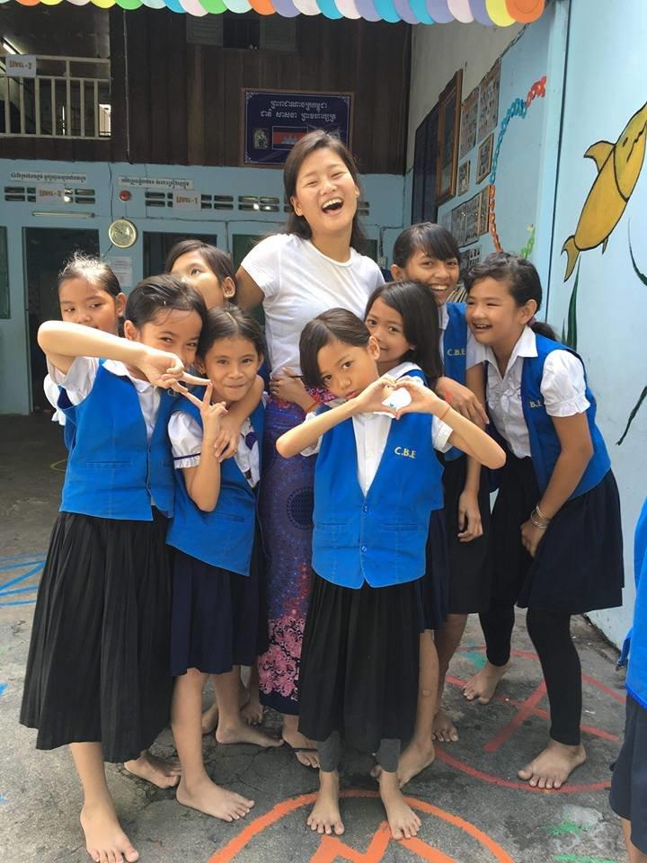 SCC teacher volunteer with her students