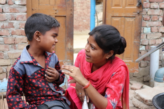 Home Visit:Field officer shares a moment w Priyank