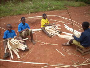 Children producng items from bamboo