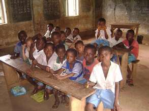 Students at the remaining dilapidated classroom