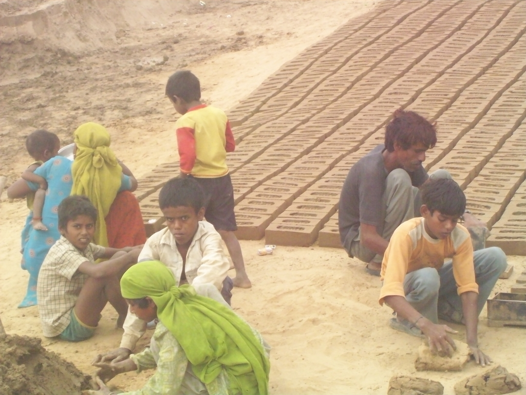 Children working at a brick kiln in Mewat