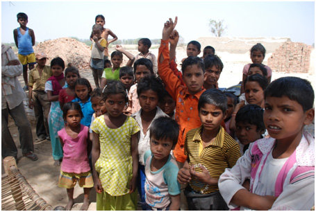 Children gather at our arrival in Lakhan