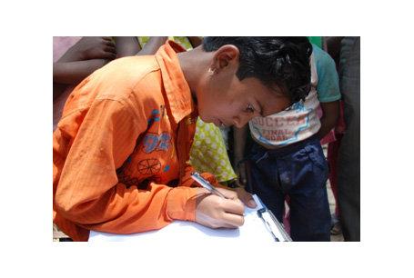 Feroz Khan, grade 3, demonstrates his writing