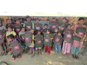 Munni (right) and her peers get school supplies