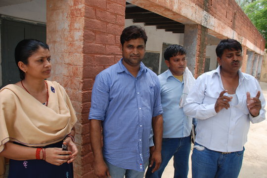 Teacher Rajinder Anand, far right, with colleagues