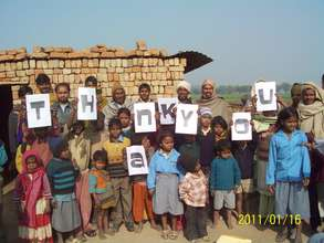 Grateful laborers and kids in Hathin block, Mewat
