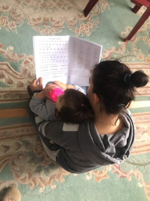 Anita passes on her learning to little Maja