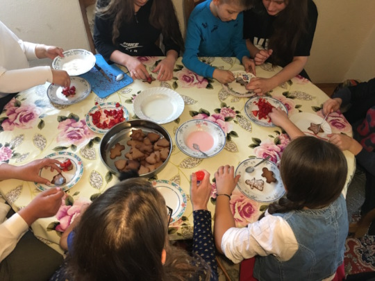 Decorating biscuits and laughing together