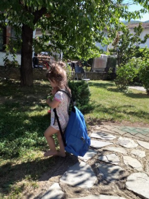 Lara practicing for nursery with a big backpack!