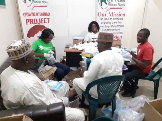 RHEMN Volunteers assembling Lifesaving Kits