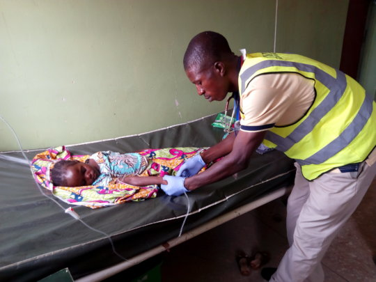 Volunteer providing care at PHC Doruwa