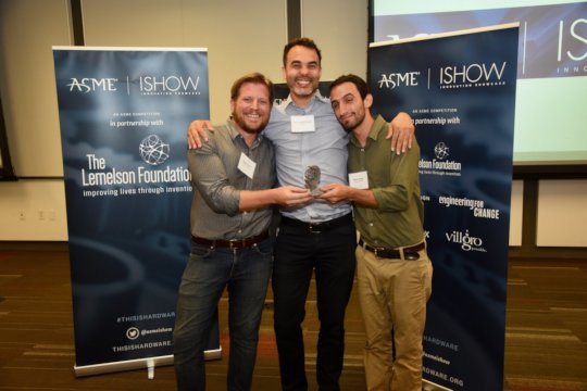 """Aaron and Dylan receiving the """"ISHOW"""" award"""