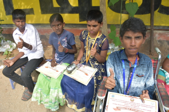 Children are happy in receiving medals