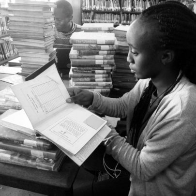 Yvette cataloguing books at the Kaloleni branch