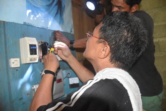 technician repairing a circuit breaker