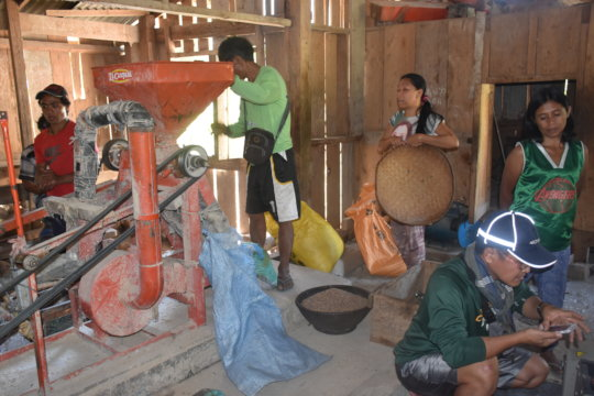women are happy their rice mills are working again