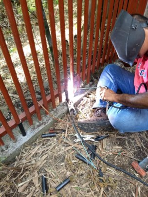 Our welder hard at work at the raptor rehab center