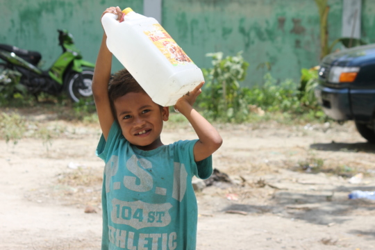 World vision distributes drinking water to familys
