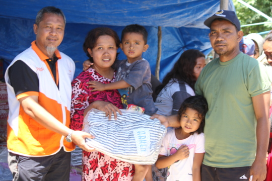 Aid Workers distribute relief items