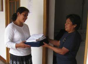 Welcoming a patient at Casa de Fe guesthouse