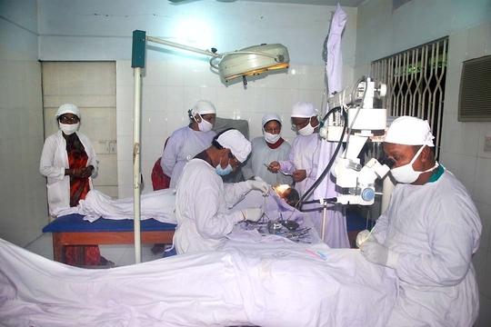 Doctors Performing Cat. Operation