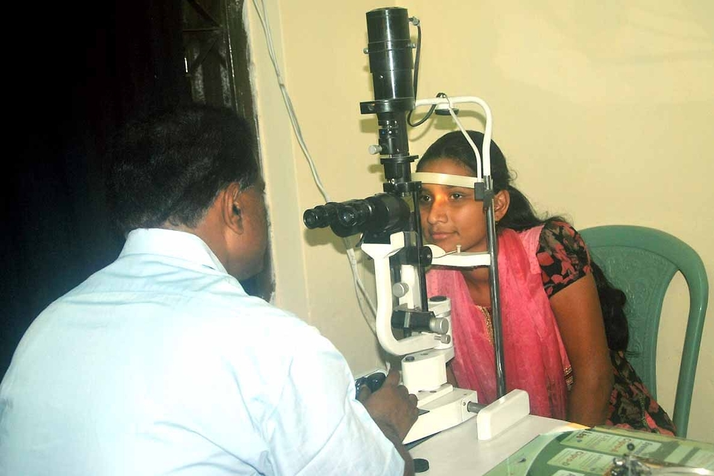 Eye Consultant Examining a Patient