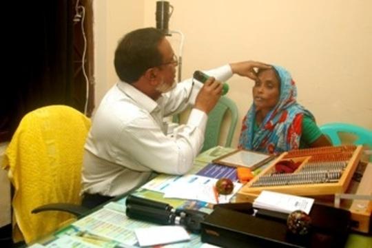 Eye Spcialist Examining a Patient