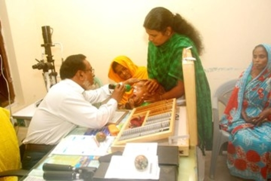 Specialist Examining a Child's Eye