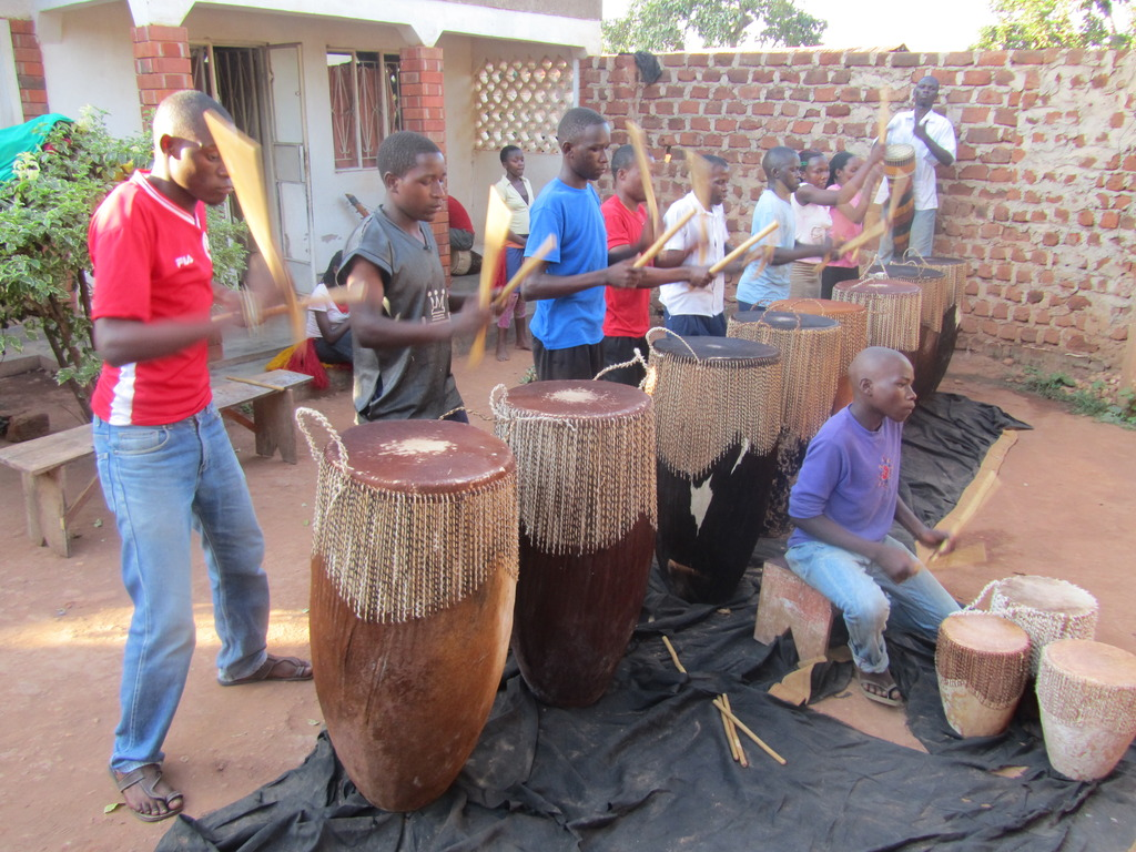 "Playing ""omugudo"" Drums"