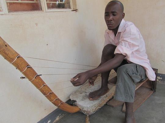 Steven Rehearsing Bass Bow Harp