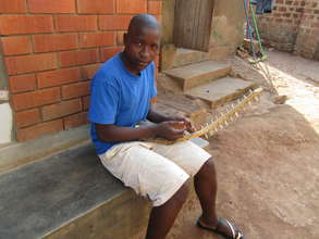 Augustine Composing on a Bow Harp