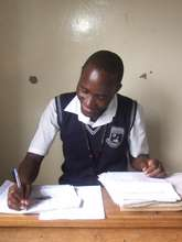 Steven in Class at Kawempe Royal