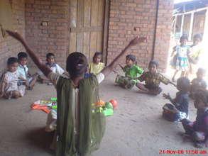 Balwadi Teacher is teaching Exercise to children
