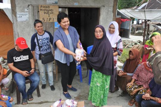 Aid distribution in Tanjung Padang