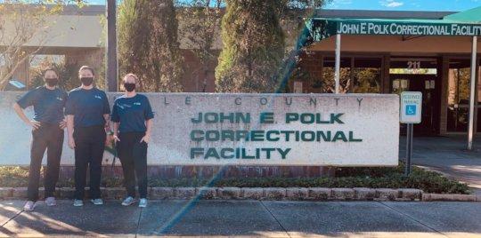 Staff outside of the John Polk Correctional