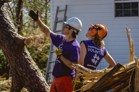 Volunteers doing chainsaw and debris work