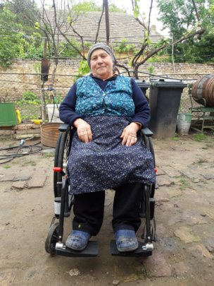 Ms. Silvia enjoys the outdoors in her wheelchair