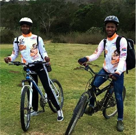 Awonke and Okuhle ready to cycle to their school.