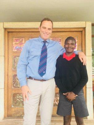 Dominic and his new headmaster, Mr Van Rensberg